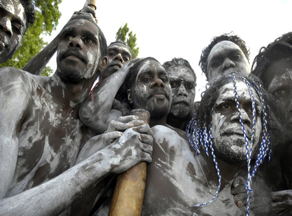 Aborigines watch the Ngunnawal ceremony at the opening of parliament in Canberra yesterday