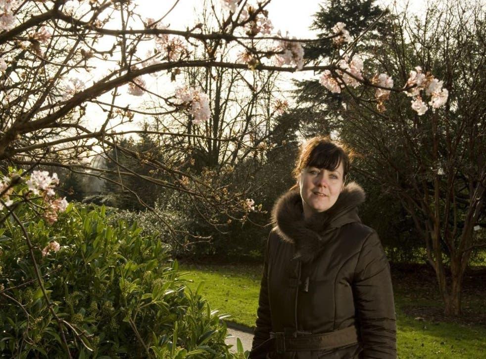 Heaven scent: Emma takes in the perfume of the viburnum shrubs at Kew © Elsa Quarsell