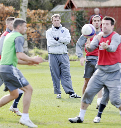 Magilton supervises an Ipswich training session yesterday. 'I said on the first day I wasn't going to mollycoddle anybody, but if they gave me everything, I would respond in kind,' he says