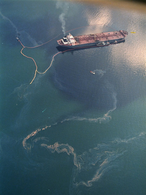 Crude oil spilling into Prince William Sound from the Exxon Valdez in 1989