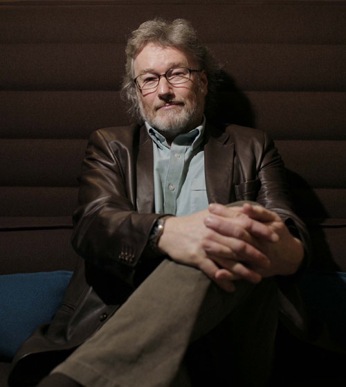 The new and fashionable post-mid-life crisis Iain Banks: wearing his new Nicole Farhi brown leather box jacket ... and loving the feel of it