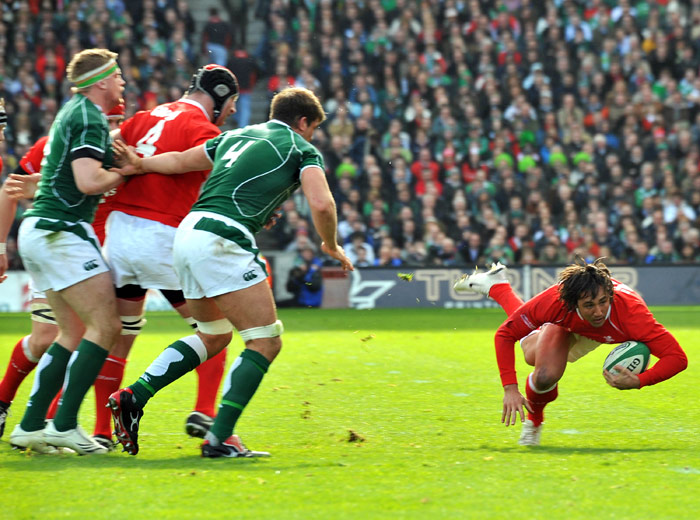 Gavin Henson (right) is off to a flier during an excellent victory for the Welsh at Croke Park to keep the Grand Slam dream alive