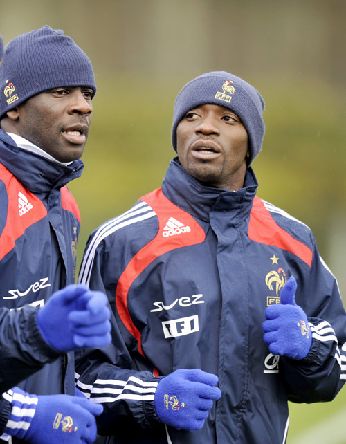 Lilian Thuram (left) and Claude Makelele are two elder statesmen splitting French opinion, eitherpropping up the reign of Raymond Domenech or stalling youngsters' development