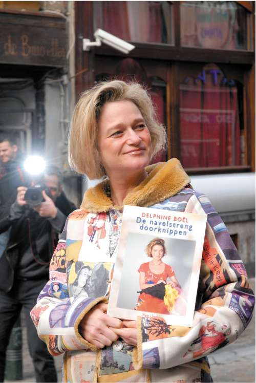 Delphine Boel, who says she is the daughter of King Albert II, with her book, Cutting the Umbilical Cord