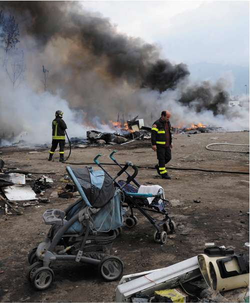 The remains of the camp set on fire on Wednesday as local people watched and applauded