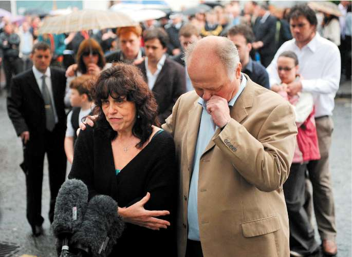 Margaret and Barry Mizen speaking to the press yesterday before the memorial service in south London for their 16-year-old son Jimmy