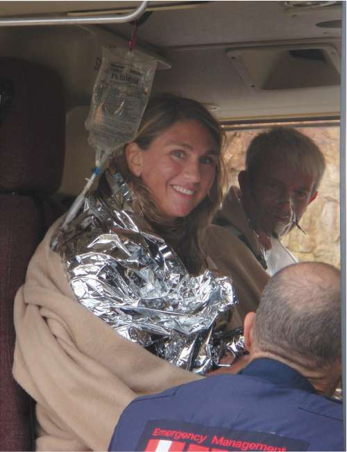 Scuba divers Alison Dalton and Richard Neely smile in a helicoptor after they were rescued