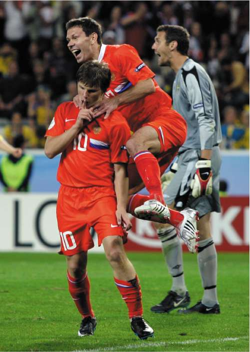 Andrei Arshavin celebrates after scoring Russia's second goal against Sweden