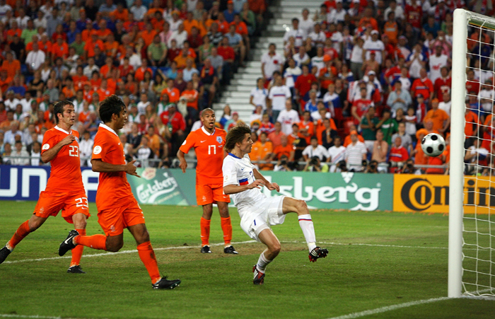 Dmitry Torbinsky gets his foot to a brilliant cross from Andrei Arshavin to score Russia's second goal