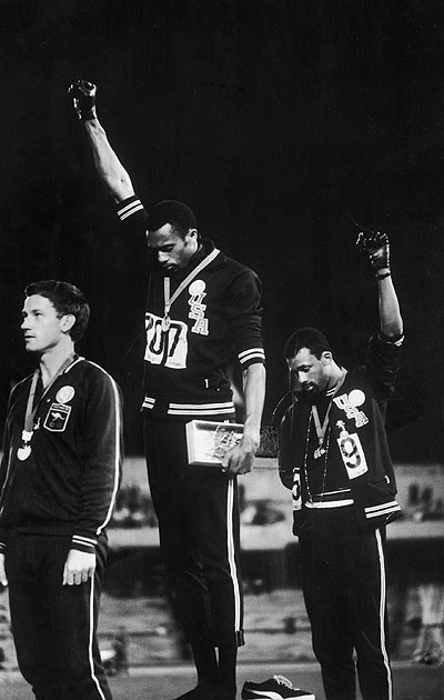 Peter Norman, left, stood proudly alongside his fellow athletes, supporting their protest.