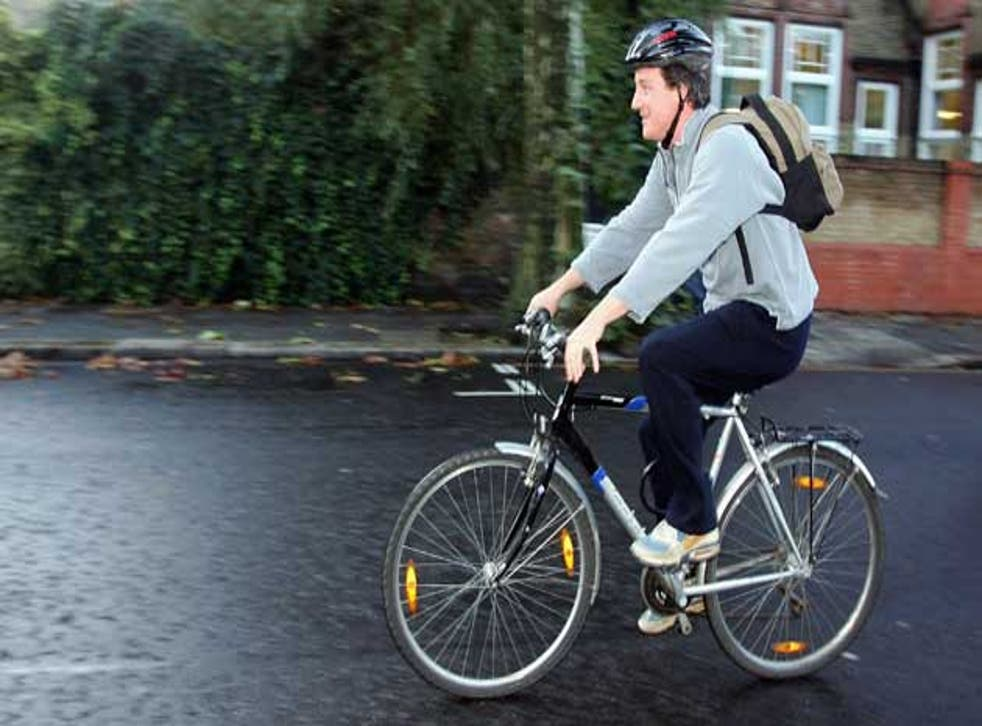 David Cameron gets on his bike