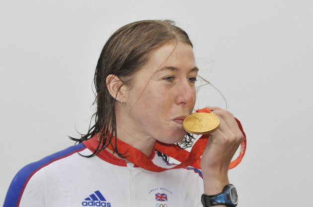 Nicole cooke of Britain kisses her gold medal after winning the woman's road race in Beijing