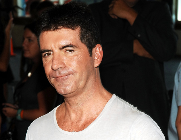 The record, masterminded by music supremo Simon Cowell to help Haiti earthquake victims, has topped the 200,000 sales mark in just two days.