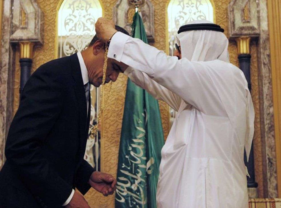 President Barack Obama is presented with a gift from King Abdullah