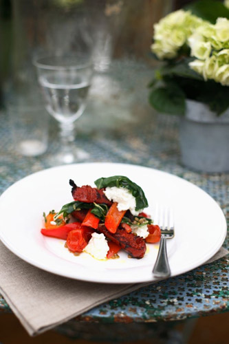 Scatter over the goat's cheese and serve while the chorizo is still warm