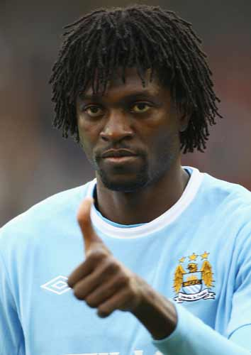 Former Arsenal striker Emmanuel Adebayor celebrated his goal - City's third - in front of furious visiting fans