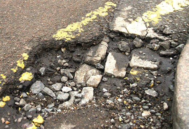 <p>A repairs backlog is leaving holes in roads for up to four months, research shows</p>