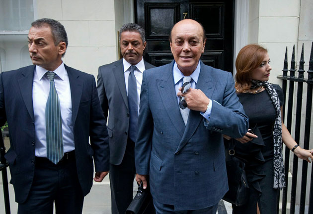 Asil Nadir (second from right) and his wife, Nur, leave their temporary home in central London