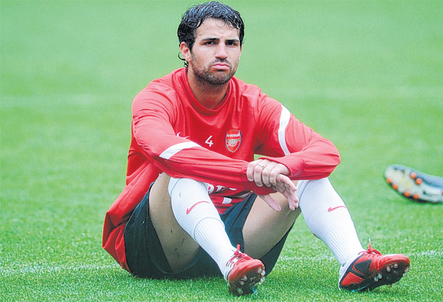 Cesc Fabregas looks lost in thought at Arsenal's training session yesterday
