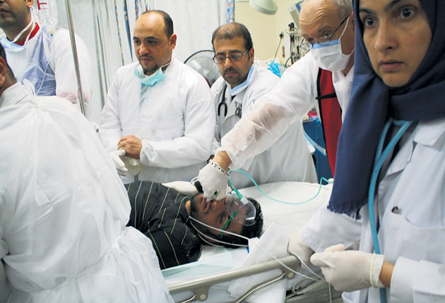 Staff at Salmaniya hospital claim injured protesters have been beaten by government forces