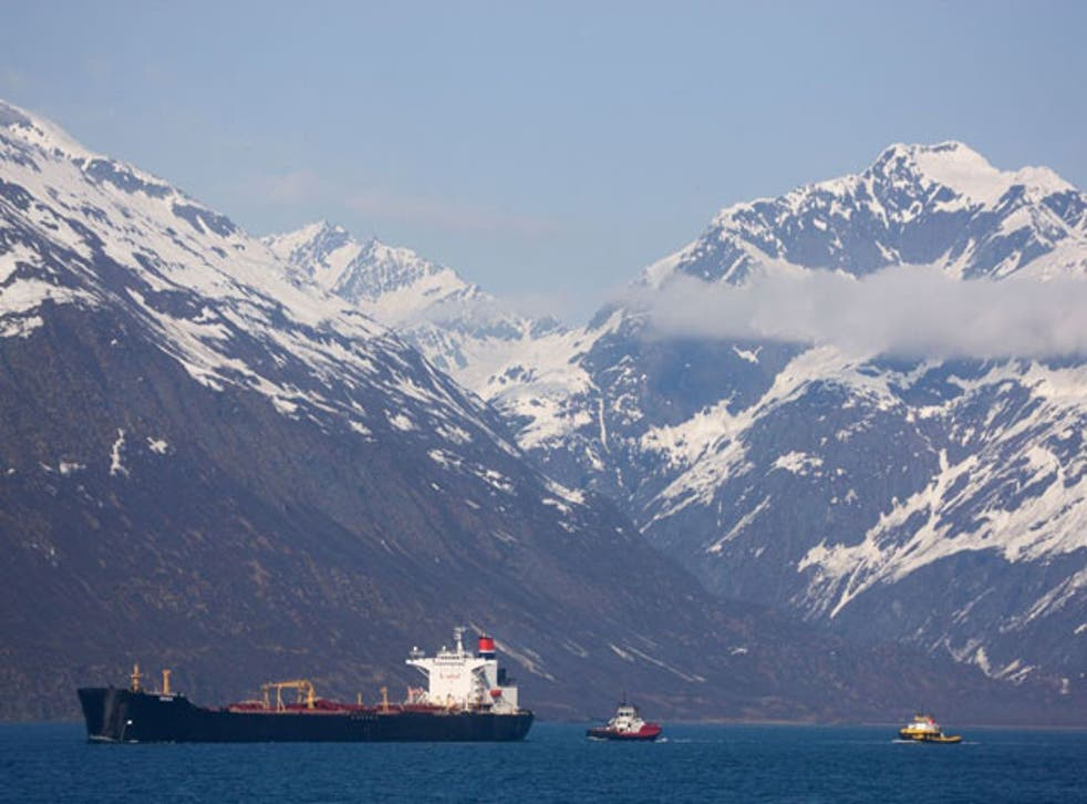 An oil tanker escorted by two tugs off the coast of Alaska