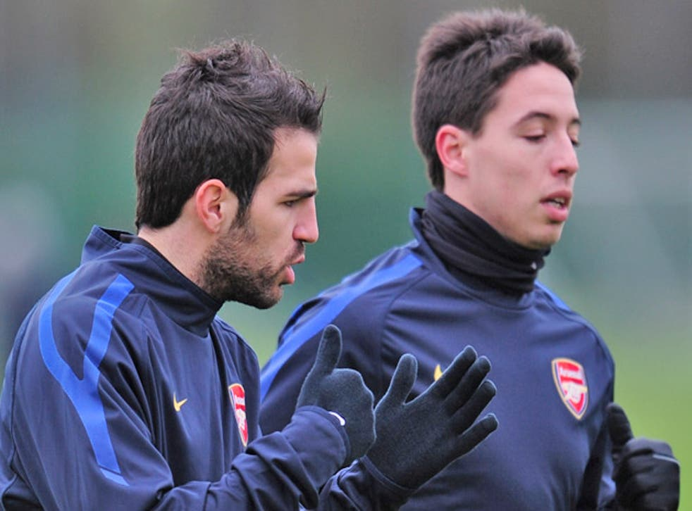 Marouane Chamakh fears Samir Nasri (right) and Cesc Fabregas will leave