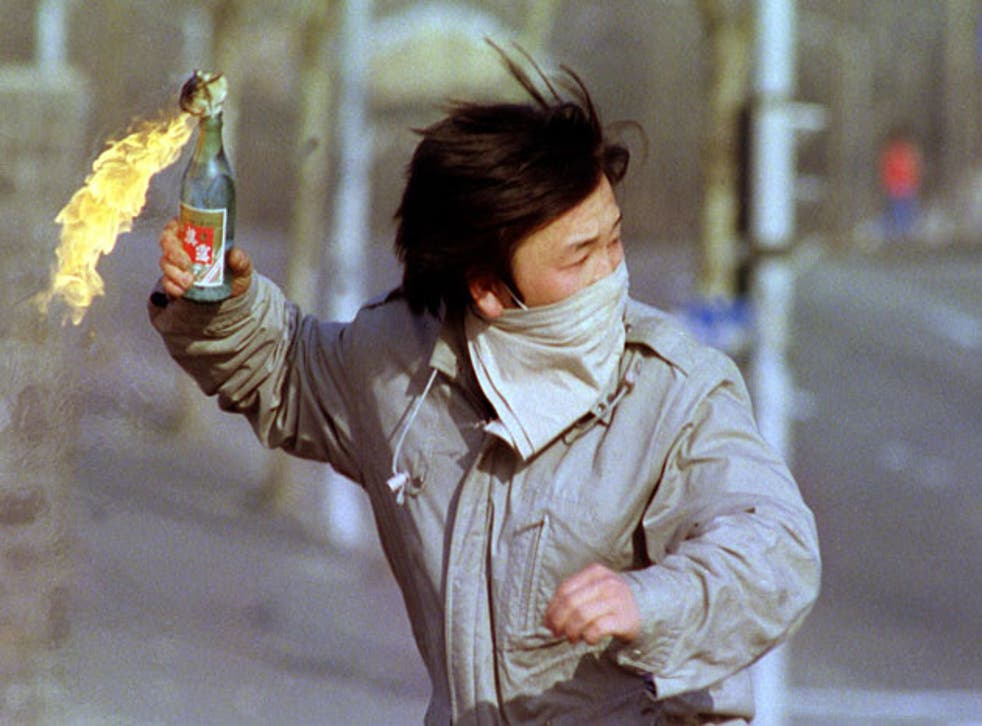 A student throws a petrol bomb in Seoul in 1988