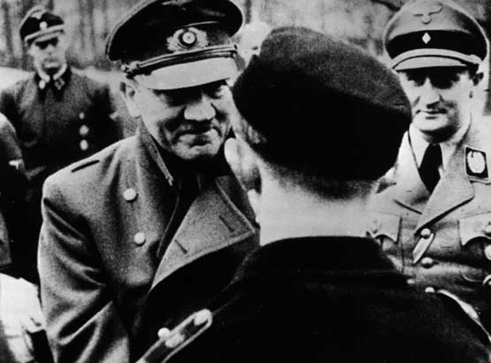 The Führer's last official photo, presenting decorations to Hitler Youth members in Berlin