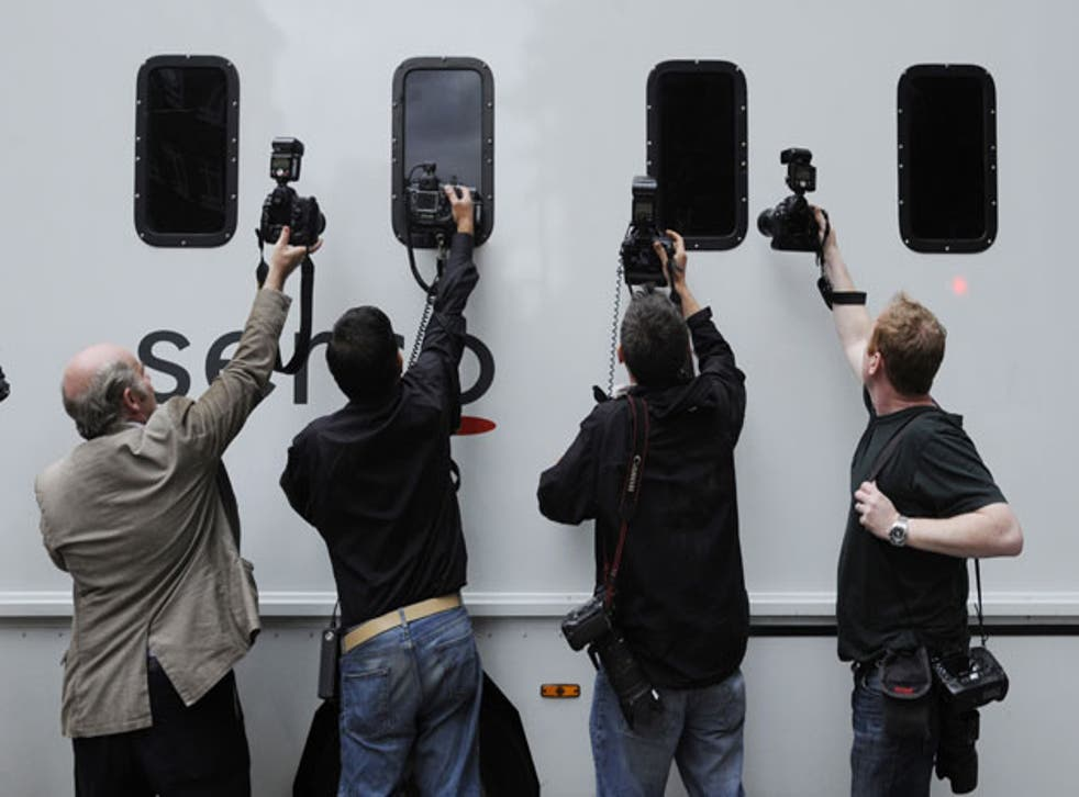 A prison van with riot suspects leaves Westminster Magistrates' Court