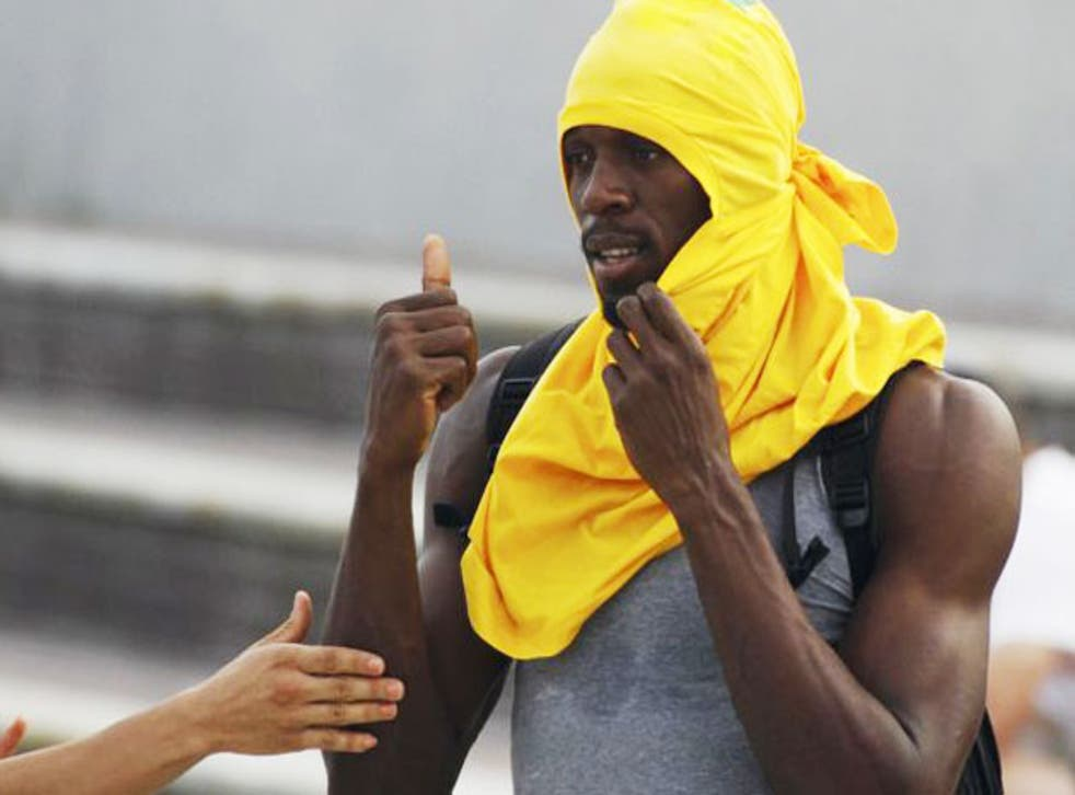 Bolt during a training session in Daegu following his disqualification from the 100m final