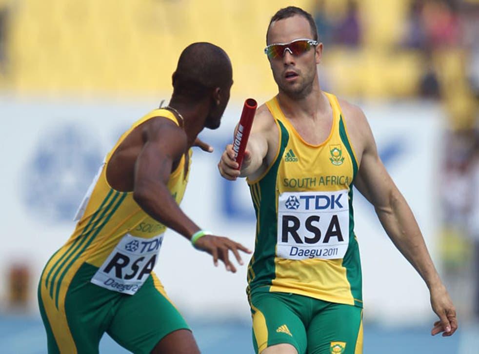 Oscar Pistorius hands on the baton during an earlier relay round in Daegu