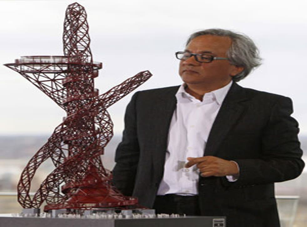 Anish Kapoor with a model of the ArcelorMittal Orbit tower which he designed with the help of three-dimensional computer imaging and will be the centrepiece of the Olympic Park in Stratford