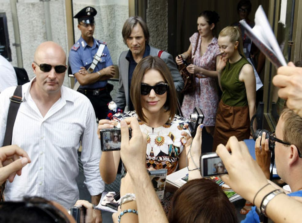 Keira Knightley leaves a press conference in Venice yesterday, followed by A Dangerous Method co-star Viggo Mortensen