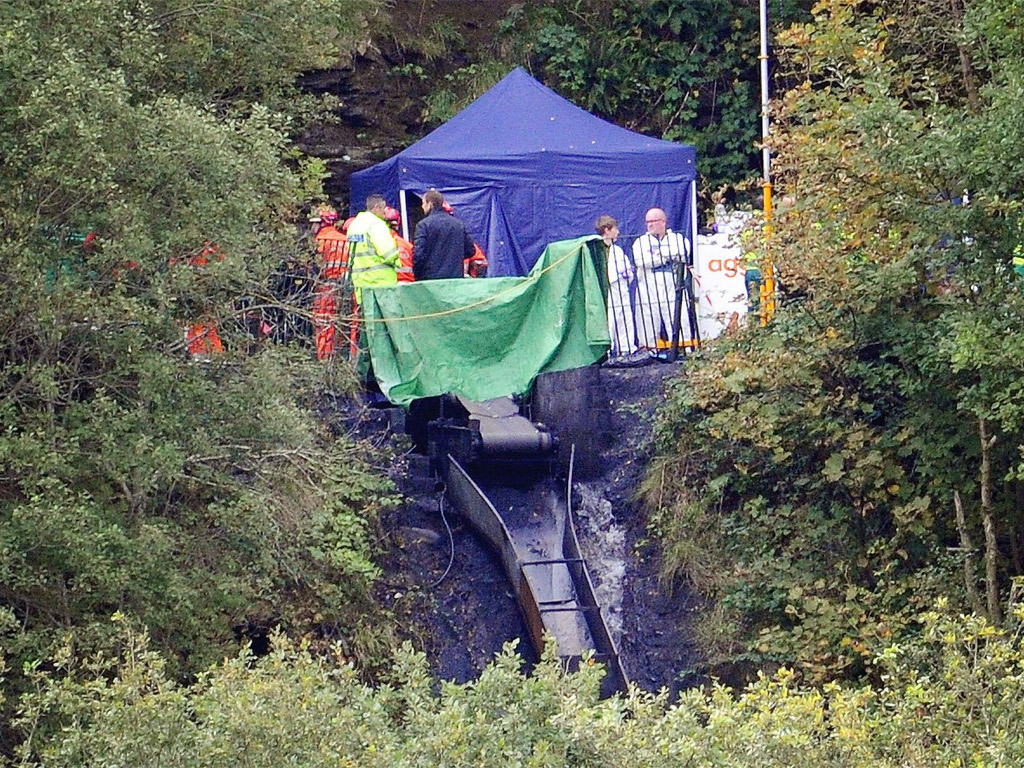<p>Rescue workers at Gleision colliery after the tragedy in September 2011</p>