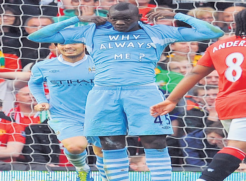 Mario Balotelli reveals his 'Why Always Me?' T-shirt at Old Trafford. He won't be wearing another one though: 'No, because otherwise I'll get booked every week,' he grinned