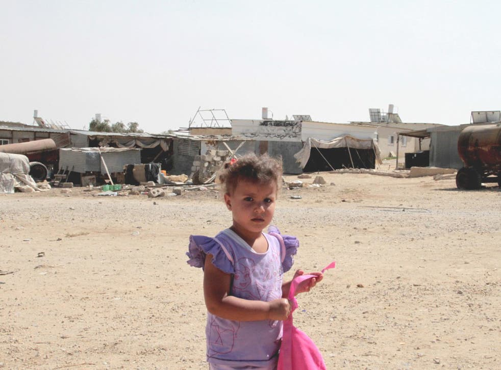 A child plays in the Bedouin town of Alsra