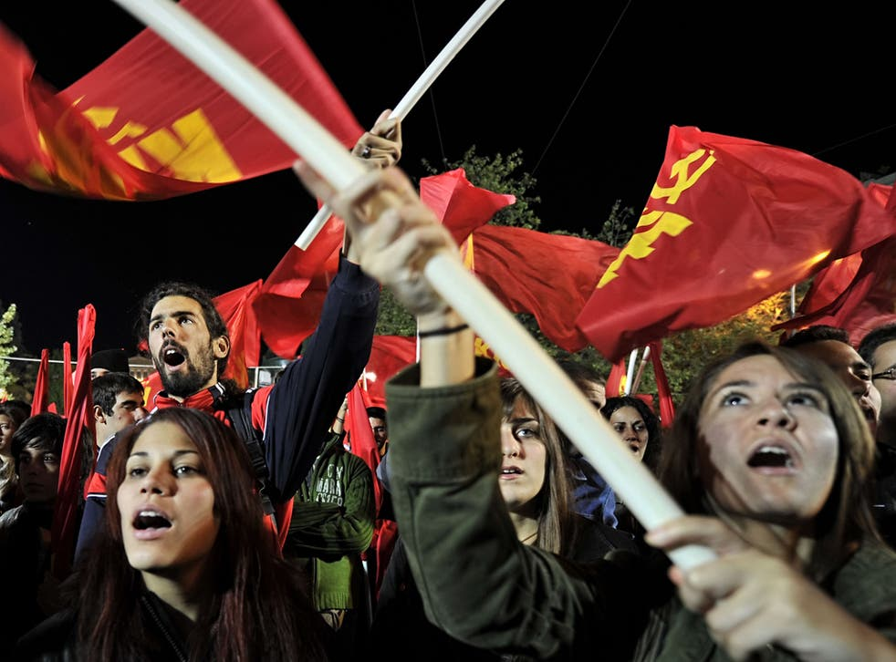 Greek Communists rally outside the parliament in Athens yesterday