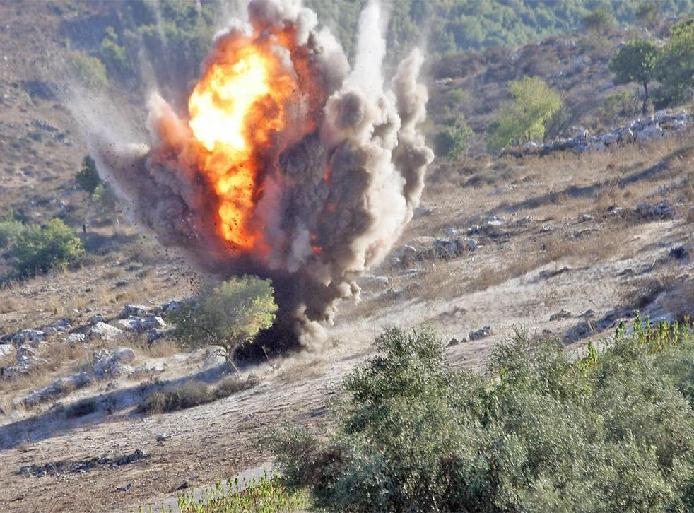 An unexploded cluster bomb is detonated in southern Lebanon