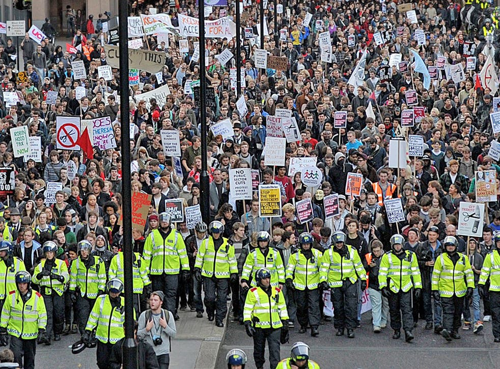 Police lead students through central London yesterday