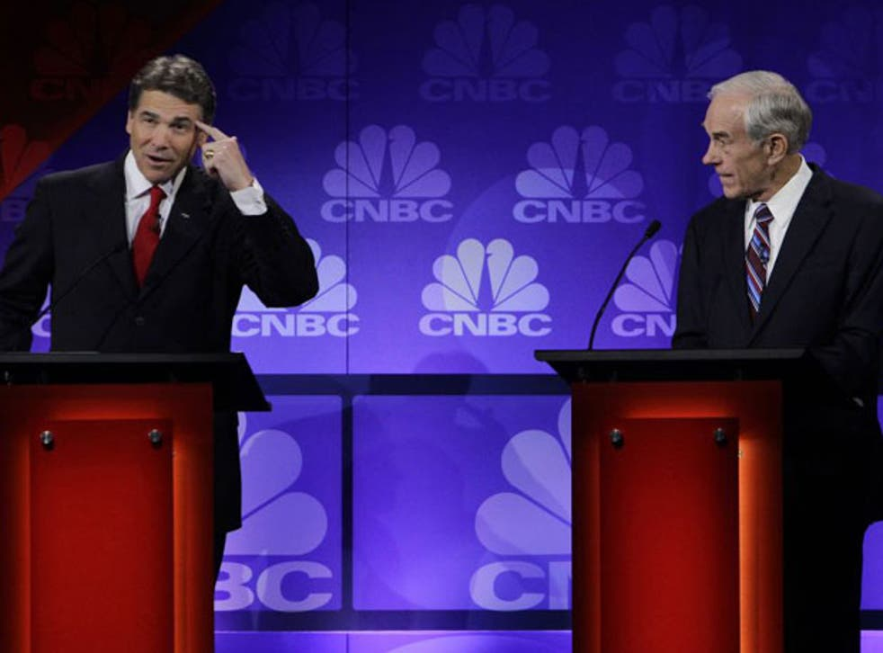 Rick Perry (left) and Ron Paul during the debate