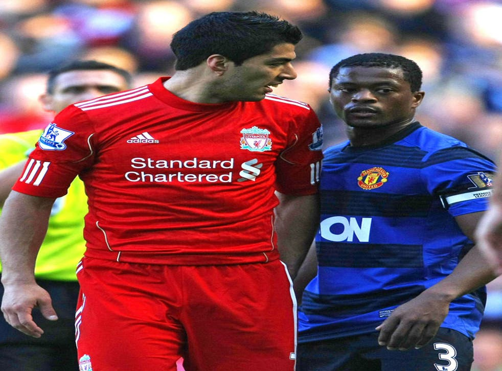 Patrice Evra and Luis Suarez exchange words during the draw at Anfield