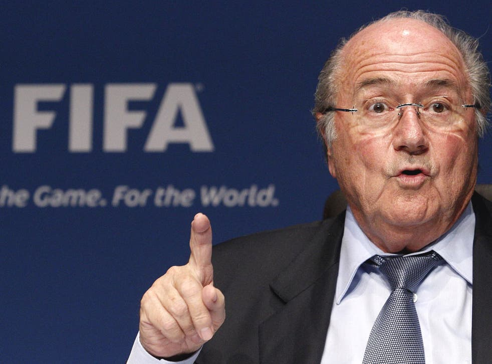 Fifa president Sepp Blatter says what little racism occurs can be solved by a handshake