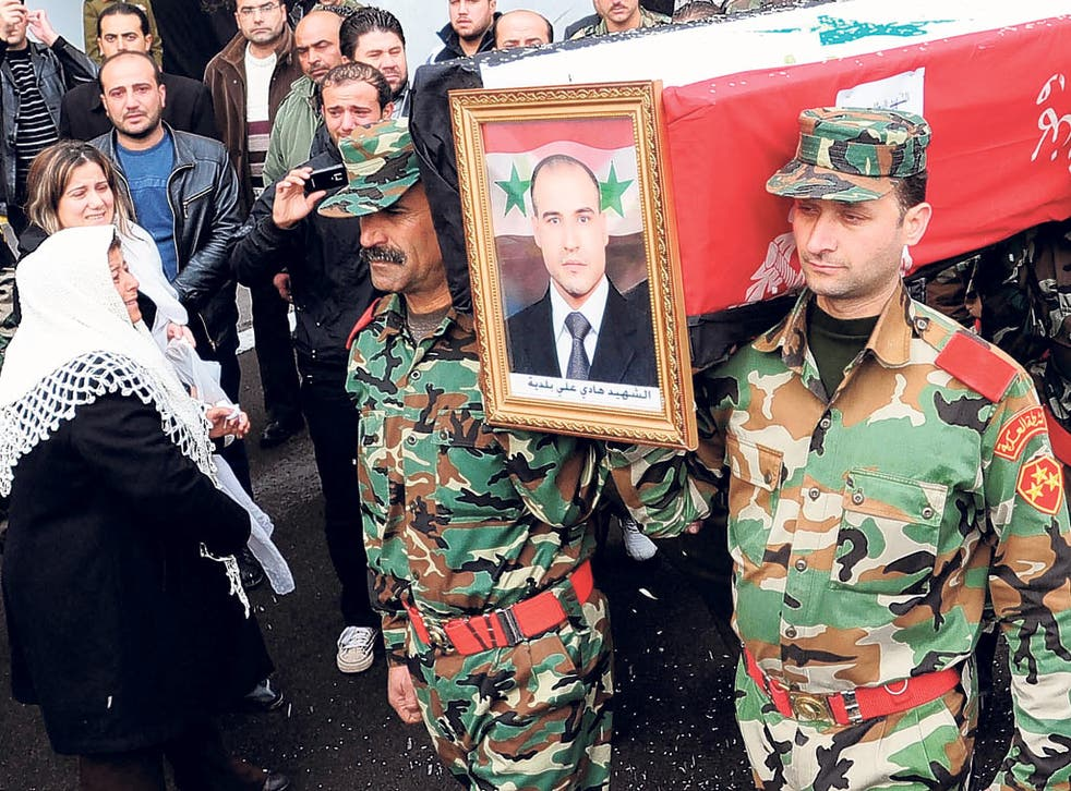 The funeral procession of Sergeant Hadi Ali Baldiah, killed by rebels, leaves a military hospital in Damascus