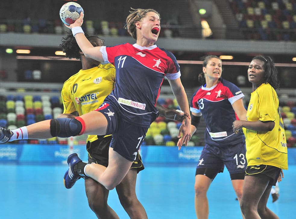 Britain's Lyn Byl shoots during the thrilling victory over Angola on day one of the London Handball Cup at the Olympic Park