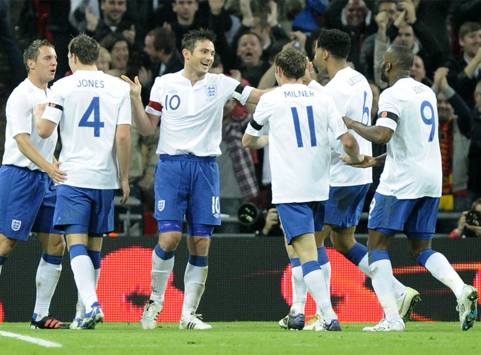 The England players celebrate their goal against world champions Spain