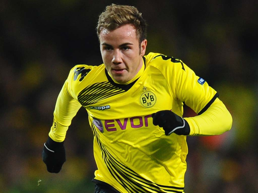 Arsenal and Manchester United tar Mario Gotze happy to stay