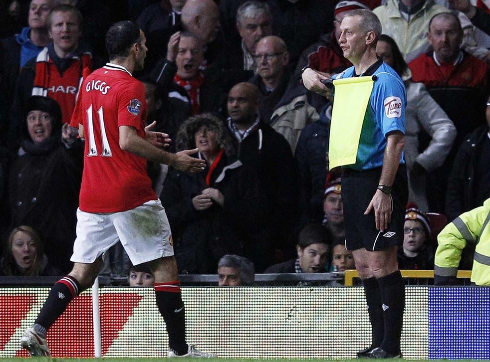 Ryan Giggs berates assistant referee John Flynn at Old Trafford on Saturday
