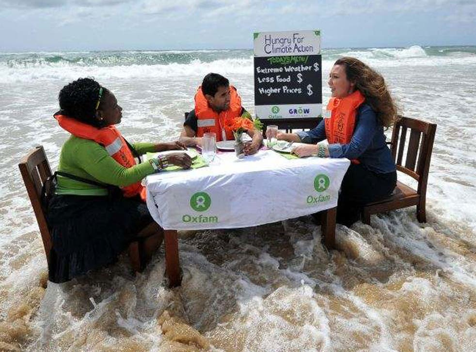Oxfam activists protest close to the UN conference on climate change in Durban yesterday