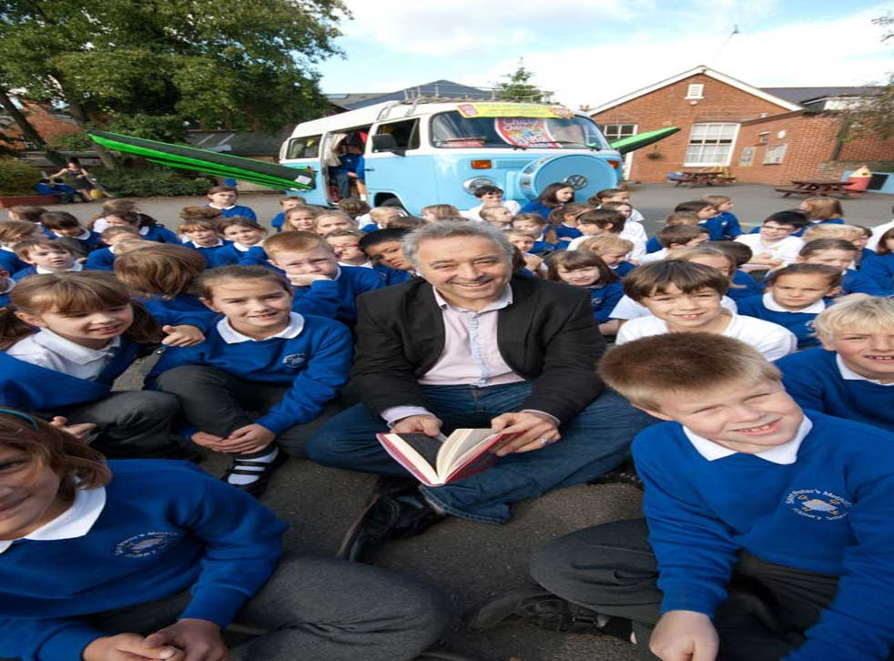 Frank Cottrell Boyce surrounded by pupils from St Peters Methodist Primary School in Canterbury