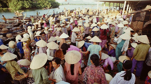 Hats off: A busy Vietnamese fish market
